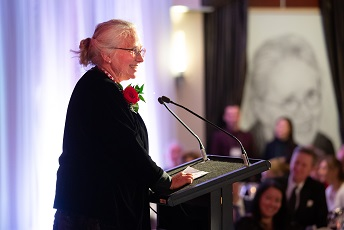Jacalyn Duffin at podium at 2019 Induction Ceremony