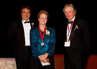 Patricia Brubaker PhD accepting award for Dr. Macleod
