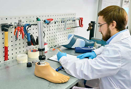 Technician working on artificial leg